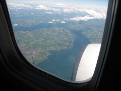 High Above Them (K.G.Hawes) Tags: sea cloud white window water netherlands clouds airplane landscape coast view cloudy farm air jet creative engine plan commons aeroplane aerial cc creativecommons farms