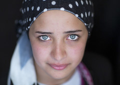 Close-up Of A Young Syrian Refugee Face With Blue Eyes, Erbil, Kurdistan, Iraq (Eric Lafforgue) Tags: camp portrait people colour eye horizontal closeup outdoors photography women asia veiled veil refugee blueeyes iraq middleeast simplicity teenager iraqi beautifulpeople erbil unhcr oneperson kurdistan arbil frontview syrian  irak kurdish kurd opop humaneye humanface colorimage darkbackground onewomanonly iraque lookingatcamera hewler irbil northerniraq iraqikurdistan thehumanbody  1people  iraaq   1415years humanbodypart     iraq2952 eraqi pa