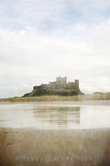 Another Bamburgh moment... (Trapac) Tags: uk winter sea england reflection building castle tourism beach water pool silhouette buildings puddle sand nikon landmark northumberland nikkor northeast defence touristattraction imposing foreshore thenorth 2014 wmh bamburghcastle northumberlandcoast nikkor3570mm d700 nikond700 tracypackerphotography wwwtracypackercom gettymomentcreativecollection