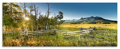 Last Dollar Sunrise Panorama (Del.Higgins) Tags: road panorama mountain last forest sunrise fence san colorado juan pano rocky national dollar burst ridgway rockie