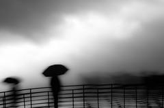 Variation 4 (PaxaMik) Tags: umbrella noir noiretblanc lumière silhouettes contraste nuages orage flou parapluie n§b silhouettefloue