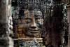 Front smiling against side one at Bayon Temple (Patumraat) Tags: thailand temple ancient asia cambodia ruin empire siem thom civilization angkor wat invasion asean ayudhaya reab khmehr
