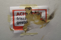 fresh paint (erix!) Tags: sign paper schild ashes papier ef burned frischgestrichen klebeband
