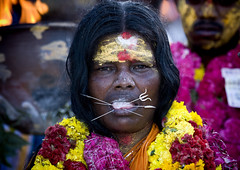 Woman With Peaks In Her Tongue, Traditional Painting On Her Forehead And A Flower Garland During A Fire Walking Ceremony, Madurai, South India (Eric Lafforgue Photography) Tags: travel portrait people woman india color colour face festival tongue horizontal outside outdoors fire pain day faith religion amman ceremony culture piercing ashes heat tradition devotees hindu hinduism madurai tamil tamilnadu oneperson saffron southindia walkonfire pilgrims mystics hindou colorimage onewomanonly lookingatcamera indianpeople waistup mg9468 devots oneadult