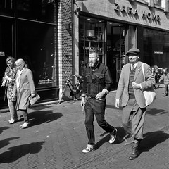 Fashion (Akbar Simonse) Tags: street people urban bw holland men blancoynegro netherlands monochrome fashion square zwartwit candid nederland streetphotography denhaag bn jeans mode thehague straat knickerbocker mannen lahaye sgravenhage agga straatfotografie