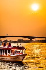River Blaze (Rooney Photography) Tags: bridge sunset sun reflection water river thailand boat nikon asia bangkok asiatique d90 theriverfront