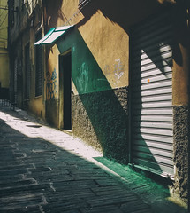 Fade love.. (areyarey) Tags: street old city travel roof light shadow summer urban italy sun sunlight color building green tourism colors shop architecture facade port vintage awning outside outdoors design store cafe italian colorful europe mediterranean european pattern quiet afternoon shadows exterior angle outdoor liguria traditional architectural sunshade genoa genova commercial shade storefront shutters shops fade typical shelter canopy residential oldtown protection narrow overhang areyarey
