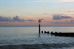 Perch (Jim-Paterson) Tags: sunset sea bird landscape clouds sky blue groyne coast dorset bournemouth