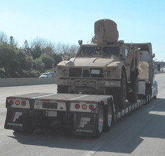 New Weapon Platform (haymarketrebel) Tags: california streetscene outdoor horizon inlandempire bigrig lowboytrailer militaryequipment freeway trees traffic semitruck tractortrailer