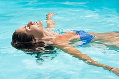 Young woman relaxing in swimming pool. (Josh_michaels) Tags: bathing bikini bikinigirl body brunettewoman care closedeyes feelinggood float floatinginpool floatingonwater freetime girl happy hotday leisure lifestyle lying mature outdoor people person pool relax relaxation relaxedperson resort resortswimmingpool summer summerholidays summervacationenjoy sunbathing swim swimmingpool swimmingpoolwater swimsuit tan tanned tannedwoman tanningwoman tranquility travel vacation water wet woman young