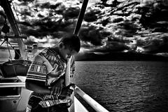 La tête dans les nuages ! (Patevy Damant) Tags: antilles atmosphère bw caraibes extérieur garçon guadeloupe jour mer monochrome nb nuages olympus