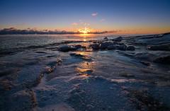 Hazy Sunset (tinamar789) Tags: sunset winter freezing cold ice icy sea seashore seascape hazy horizon mist fog rocks suomenlinna helsinki finland