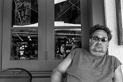 Cool Dude in New Orleans. (moony: stupidly dreamy) Tags: man reflection guy monochrome cool neworleans shades tourist attitude nola blacknwhite relaxed