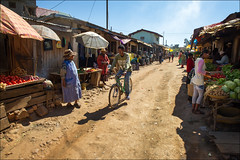 ambatolampy-5770-ps-w (pw-pix) Tags: street people vegetables bicycle shopping dirt shops rough madagascar ambatolampy stalls rutted townisfamousforaluminiumcasting