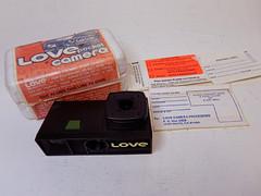 "Lure Camera Inc ""Love"" disposable camera (Mark Dalzell) Tags: camera love headshot 16mm inc lure disposable magicube mailer"