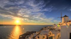 Sunset in Oia (colinemcbride) Tags: blue sunset sea church clouds boats skies republic aegean cliffs greece caldera dome ia hdr oia cyclades thira fira thera nea akrotiri hellenic firostefani kameni domed  therasia
