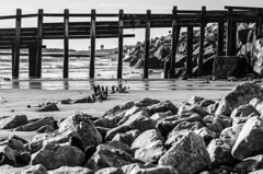 (Damien Cox) Tags: uk sea people blackandwhite beach water sand nikon rocks waves westsussex walkers elmer groin bognorregis damiencox dcoxphotographycom