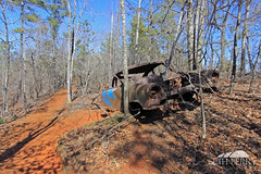 Stuck (Seth Berry Photography) Tags: statepark park old usa abandoned car georgia state little south small grand canyon east providence erosion soil clay rusted 1950s land southeast providencecanyon littlegrandcanyon providencecanyonstatepark sethberryphotography
