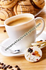 Coffee and milk chocolate candy (Olena Mykhaylova) Tags: morning food brown white black cup coffee closeup table dessert cuisine break flavor candy drink sweet chocolate coffeecup cream plate bean gourmet delicious snack sweets leisure aroma nutrition
