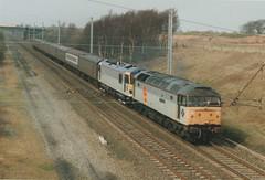 "Railfreight Distribution Class 47/0, 47206 ""The Morris Dancer""  & SNCF Class 92, 92028 ""Saint Saens"" (37190 ""Dalzell"") Tags: acdc electric br spoon brush britishrail duff dyson sncf wigan sparkies worthington saintsaens rfd class47 railfreightdistribution class92 triplegrey brush4 class470 92028 trainloadfreight standishjunction 47206 themorrisdancer metalpolologos"