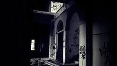 La oscuridad del tiempo. (zumodecerebro) Tags: woman white luz stairs hospital atardecer gris evening ruins doors afternoon shadows empty ghost deep forgotten ruinas sombras arcs pasillo tarde escaleras graffitis sanatorio abandonado zumodecerebro aiguesdebusot