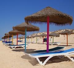 Colour on the Beach (SuQ10) Tags: beach portugal algarve sunshades sunparasols