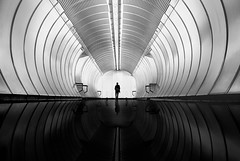 ... backtomycity... (*ines_maria) Tags: vienna austria city urban urbanart architecture tube person man futuristic ceiling perspective step indoors modern station reflection hss panasonicdmcgx8 bnw bw monochrome mono metro u1