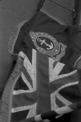 Cadet Corps flag (Julian Dyer) Tags: vintage blackwhite events yorkshire 35mmfilm ilforddelta400 fujicast705 haworth ilfordddx haworth1940sweekend haworth1940s