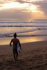 Sunset surfing at Kuta Beach, Bali