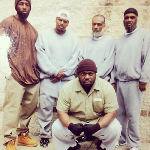 Beanie Sigel prison picture . in the yard with his crew of old heads