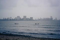 Marine lines from Chowpatty ([s e l v i n]) Tags: city sea sky india beach buildings cloudy minimal bombay land layers mumbai chowpatty chowpattybeach marinelines ©selvin