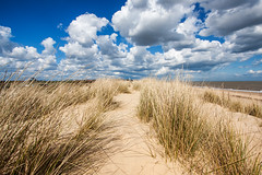On The Dunes (Jeremy Vickers Photography) Tags: holiday beach grass sunshine clouds landscape coast suffolk seaside spring warm bright wideangle bluesky british southwold sanddunes canonefs1022mmf3545usm canoneos40d