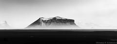 Ptursey (Kristinn R.) Tags: sky mountains clouds blacksand blackwhite iceland nikon d3x slheimasandur nikonphotography kristinnr