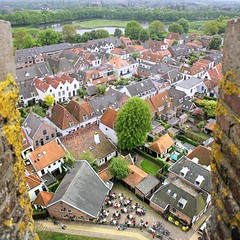 View from St. Vitus Church of the fortified city of Naarden (Bn) Tags: city holland history church netherlands topf50 basilica gothic tourist medieval canals explore kings napoleon walls uitzicht middle visitors viewpoint bastion trade topf100 fortress ages kerk defence oranje muur gooi naarden vesting fortified stvitus starshaped emperors bastions wallen militairy basiliek stadswallen 100faves 50faves 73m restaurant360 kerkpad vituskerk vestingsstadje