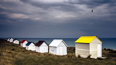 The beach huts (Lucien Vatynan) Tags: mer seascape france colors canon eos couleurs normandie tamron normandy manche cabines littoral gouville 500px 60d ifttt