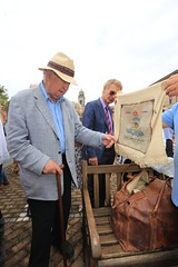 Michael Lacey inspects belongings found at PoW camp