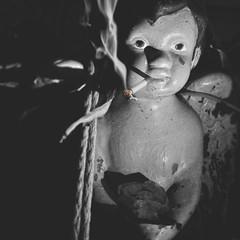 sixty three | 365 III {explore} (Randomographer) Tags: bw white black face statue angel night dark rebel cigarette being smoke 63 smoking explore photograph cherub addicted smoker winged angelic tough cherubim project365 rslphotography rslphotographics