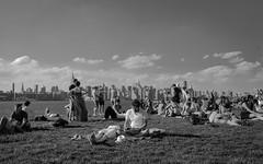 East River Park (...1,000 Words) Tags: park nyc summer bw ny newyork skyline brooklyn river blackwhite concert nikon weekend lounging sunbathing eastriverpark 18200mm d80