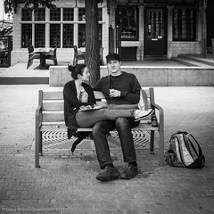 Lovers on a Bench (gwpics) Tags: people blackandwhite bw woman man male girl monochrome lady female bench person mono women couple sitting belgium drinking streetphotography lifestyle belgian antwerp society antwerpen socialdocumentary socialcomment streetpics strasenfotograpfie