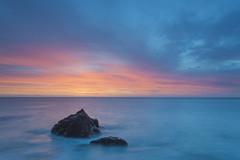 breaking dawn (zip po) Tags: howth sunrise dublin ireland dawn orange yellow pink sea rock longexposure landscape sky coast morning