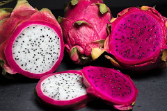 Red and White Dragon Fruit Cut Up on a Cutting Board (Transient Eternal) Tags: food hylocereus stenocereus crunchy dessert dinner dragonfruit eat fruit fuschia good healthyfood juicy meal nutrient nutritious pink pitahaya pitaya seeds superfood sweet white
