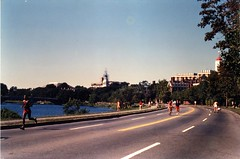 """Joggers and Bicyclists on Memorial Drive"" (Cambridge Room at the Cambridge Public Library) Tags: colorprintsphotographs lombardimonica monicalombardi cambridgemass charlesrivermass photography19801990 photographycompetitions"