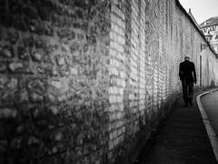 sunday walk (Sandy...J) Tags: walking wall urban blackwhite bw monochrom man streetphotography atmosphere olympus city photography
