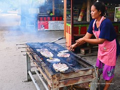 Grilling Fish (Rudy Sempur) Tags: indonesia lombok westnusatenggara ntb sundalesser cook grill barbecue culinary fish food woman restaurant