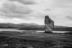 Loneliness (MF[FR]) Tags: 2016 ecosse lewisandharris scotland island landscape sea clouds black white 50mm samsung mer noir et blanc paysage nuage menhir callanish lewis harris île neolithique nx1 callanais