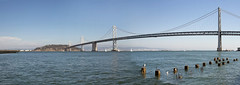 Oakland Bay Bridge Over San Francisco Bay (JPLPhotographyPDX) Tags: sf california park ca travel bridge panorama seagulls tourism public water port landscape island oakland bay harbor pier san francisco waterfront treasure view 14 scenic landmark structure transportation area sailboats yerba piling rincon buena
