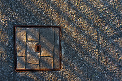stone sewel in the floor (Mikel Martnez de Osaba) Tags: street sunset urban detail texture industry stone underground square industrial floor pavement background bricks drain textures sidewalk cover sewage gutter manhole textured drainage
