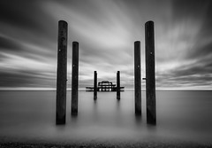 overture (vulture labs) Tags: uk longexposure sea england urban blackandwhite bw seascape west london art abandoned water monochrome architecture clouds fire photography mono coast pier photo seaside movement nikon brighton long exposure industrial monotone monochromatic symmetry damage monolith derelict overture