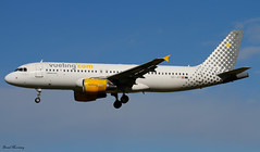 Vueling A320-200 EC-JFF (birrlad) Tags: barcelona brussels sunlight airplane airport spain aircraft aviation airplanes bcn landing finals airline airbus arrival airways approach airlines runway airliner a320 vueling a320200 a320214 25r