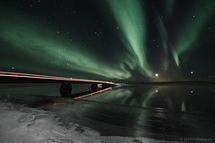 Bridge to the other side (Friðþjófur M.) Tags: canon5dmarkii samyang14mm friðþjófurm frozen winter snow northernlights norðurljós nordlicht norðvesturland iceland ísland iso1600f28 reflection moonlight stars colors cloud landscape lake river lights carlights outdoor cold road frozenwater frost ís icelandic tindastóll mountain